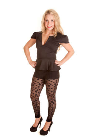 A woman with her hands on her hips, wearing her see through leggings and a black top. Imagens