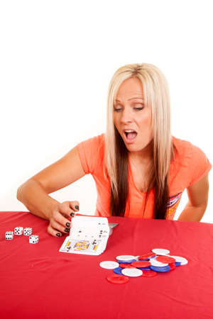 A woman showing a trick, by flipping cards over. photo