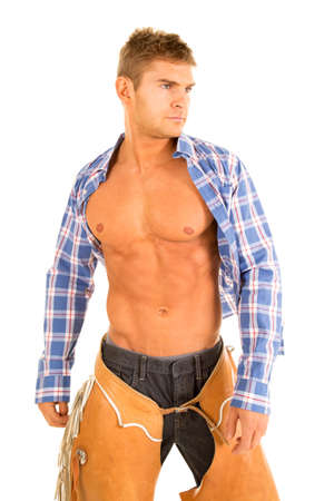shirt unbuttoned: A cowboy with his plaid shirt unbuttoned showing off his chest.