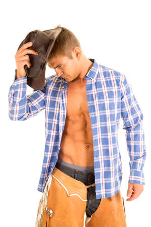 shirt unbuttoned: A cowboy with his shirt unbuttoned and showing off his chest.
