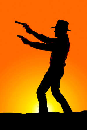a silhouette of a cowboy pointing two pistols to the side. photo