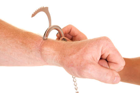handcuffing: a man with a handcuff by his wrist.