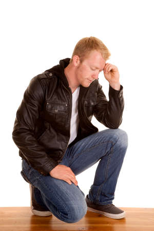 deep thought: a man in his leather jacket in deep thought. Stock Photo