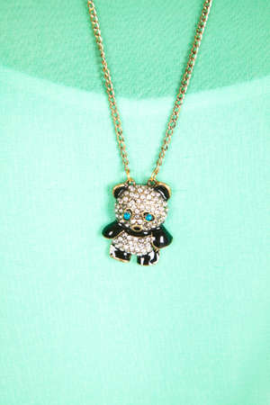 a necklace with a panda pendant on the end of the necklace. photo