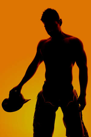 rancher: A silhouette of a cowboy with his shirt off, holding on to his hat.