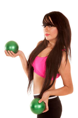 weighted: A woman in her fitness working out with green weighted balls.