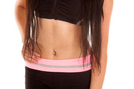woman's clothing: A womans stomach in her fitness clothing with her long hair showing.
