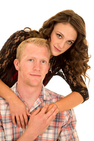 leans on hand: a man touching her womans hand as she leans over his shoulder Stock Photo