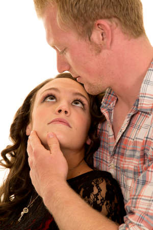 lust: A woman looking into her mans eyes with a look of lust. Stock Photo