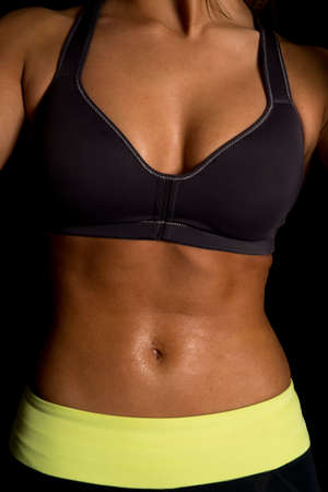 a close up of a womans body sweating.