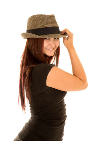 brim: a woman in a hat touching the brim. Stock Photo