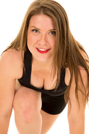brunett: A woman in her fitness stance with a smile on her face.