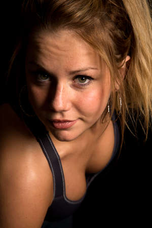 A woman in her black sports bra, sweating after a work out Stock Photo