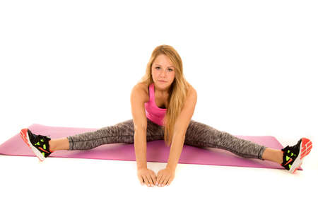 out of body: A woman in her straddle position stretching out her body. Stock Photo