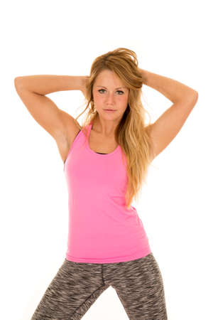 arms out: A woman in her fitness clothing stretching her arms out.