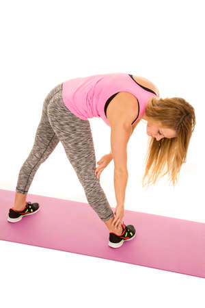 out of body: a woman stretching out her body on a fitness mat.