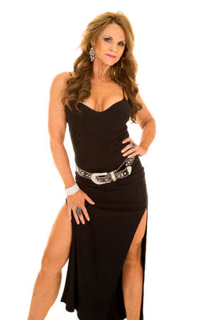 a mature woman in her black dress with her legs showing.
