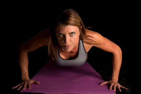 push: A woman doing a push up on her fitness mat.