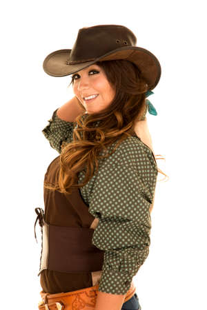 sexy cowgirl: A cowgirl with a big smile on her face, looking to the side in her cowgirl hat, and her holster on.