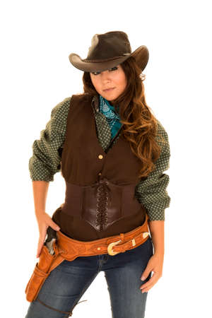 smirk: a cowgirl with her hand on her pistol with a smirk on her face.