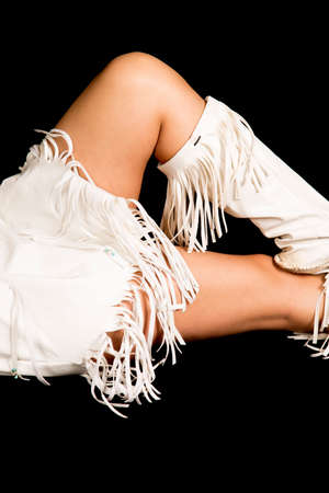 moccasins: A Native American woman on black, with her moccasins showing. Stock Photo