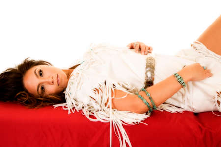 a Native American woman laying and looking to the side in her traditional dress. Stock fotó