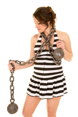 prison ball: a pregnant woman in her prison dress, with a ball and chain around her neck.