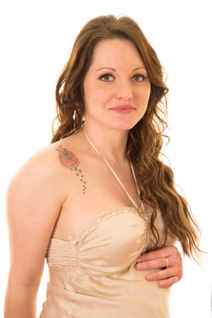 A woman in her night dress with her rose tattoo showing.