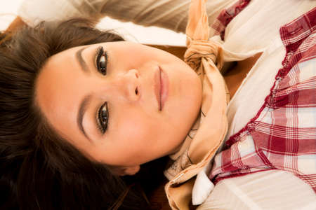 bandana western: A close up of a woman in her western wear with a sensual expression on her face. Stock Photo