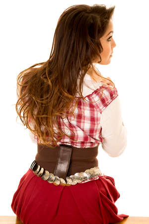 red plaid: a woman in her red plaid top and western clothing, looking over her shoulder