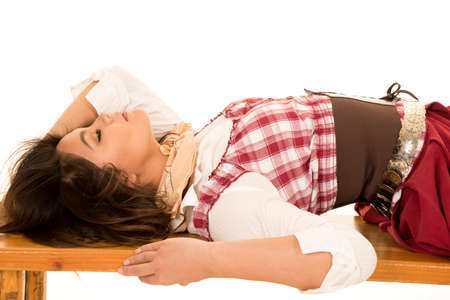 bandana western: A woman laying back on a wooden bench, with her eyes closed and relaxing.