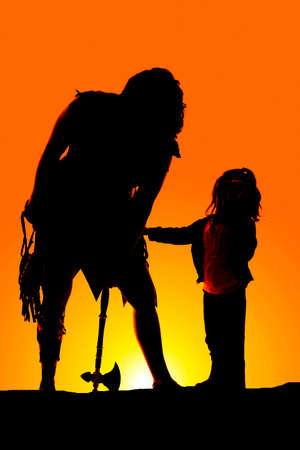 a silhouette of a cave woman with her little girl. photo