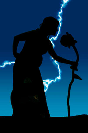 A silhouette of a pregnant woman leaning over to a giant rose. photo