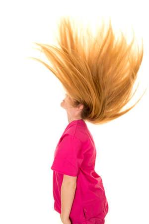 When a woman flips her hair