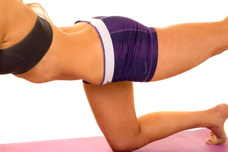out of body: A fit woman working out her body, and stretching