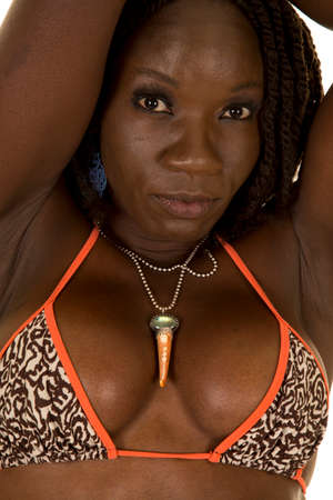 A close up of an African American woman looking Banco de Imagens