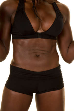 An African American woman showing off her abs. Stock Photo - 40915974