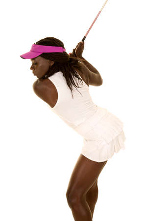 An African American woman getting ready to swing her club.