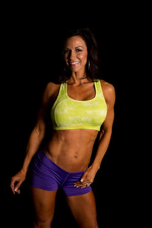 tight body: A fit woman showing off her tight body with a smile. Stock Photo