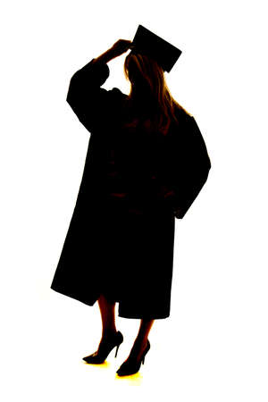 academic robe: a silhouette of a woman in her graduation cap and gown. Stock Photo