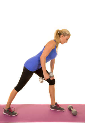 physically fit: a woman being physically fit working out her arm. Stock Photo