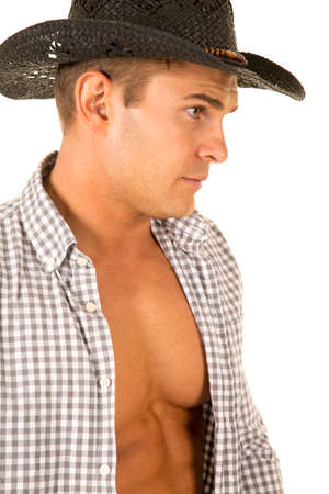 undone: A close up of a cowboy with his shirt undone, showing off his muscular chest.