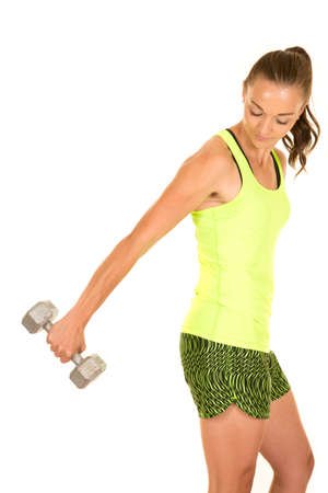 tricep: a woman doing her tricep extension working out her arms with weights.