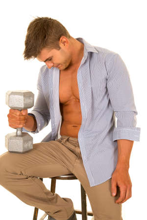 shirt unbuttoned: A man with a weight on his knee, with his dress shirt unbuttoned.