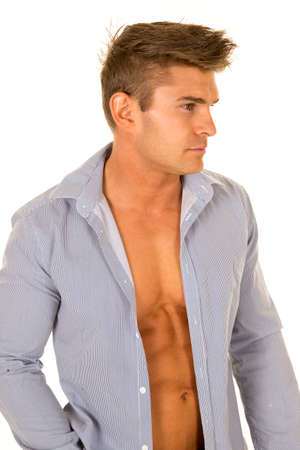 shirt unbuttoned: A man in his business shirt unbuttoned showing off his chest,