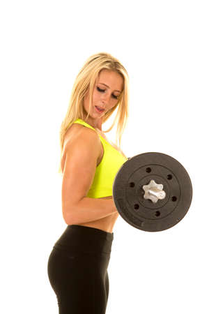 weighted: a woman in her fitness clothing holding on to her weighted bar. Stock Photo