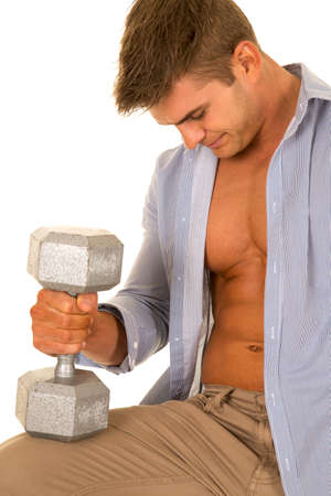 shirt unbuttoned: a man with his shirt unbuttoned holding a weight on his knee.