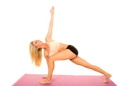 tight fit: A woman doing a yoga stretch after a workout.