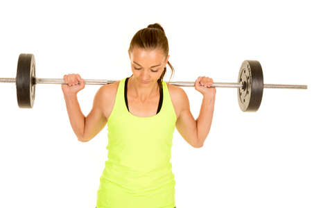 tight fit: a woman with a weighted bar across her back, looking down.