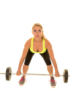 a woman doing a dead lift working out her legs. Stock Photo